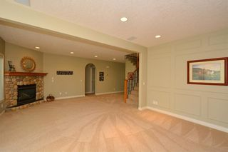 Photo 39: 104 GLENEAGLES Landing: Cochrane House for sale : MLS®# C4127159