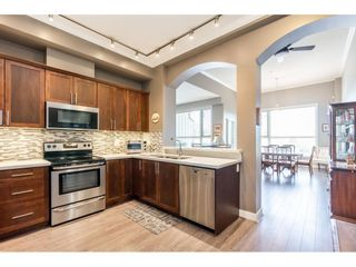 """Photo 5: 405 2627 SHAUGHNESSY Street in Port Coquitlam: Central Pt Coquitlam Condo for sale in """"Villagio"""" : MLS®# R2595502"""