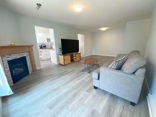 Photo 2: 202 14981 101A Avenue in Surrey: Guildford Condo for sale (North Surrey)  : MLS®# R2606277
