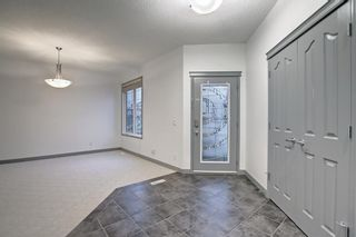 Photo 4: 163 Springbluff Heights SW in Calgary: Springbank Hill Detached for sale : MLS®# A1153228