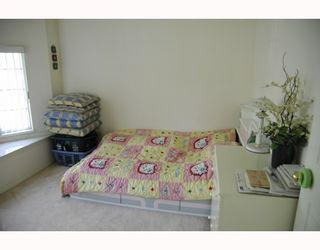 Photo 8: 3678 E Pender Street in Vancouver East: Renfrew VE House for sale : MLS®# V811892