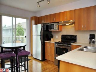 """Photo 4: 67 15155 62A Avenue in Surrey: Sullivan Station Townhouse for sale in """"THE OAKLANDS"""" : MLS®# F1218827"""