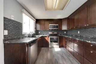 Photo 1: 152 LEE_RIDGE Road in Edmonton: Zone 29 Townhouse for sale : MLS®# E4241541