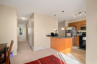 Photo 7: 38 Eversyde Common SW in Calgary: Evergreen Row/Townhouse for sale : MLS®# A1144628