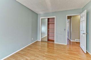 Photo 12: 316 Queen Alexandra Road SE in Calgary: Queensland Detached for sale : MLS®# A1104461