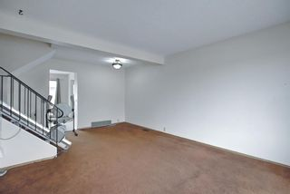 Photo 8: 329 Woodvale Crescent SW in Calgary: Woodlands Semi Detached for sale : MLS®# A1093334