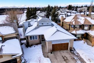 Photo 1: 113 Woodridge Close SW in Calgary: Woodbine Detached for sale : MLS®# A1060325