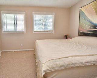 Photo 11: 816 MADEIRA Drive NE in Calgary: Marlborough Park Row/Townhouse for sale : MLS®# C4262604