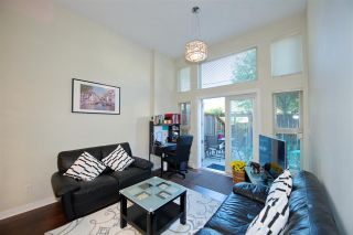 """Photo 1: 102 3688 INVERNESS Street in Vancouver: Knight Condo for sale in """"Charm"""" (Vancouver East)  : MLS®# R2488351"""