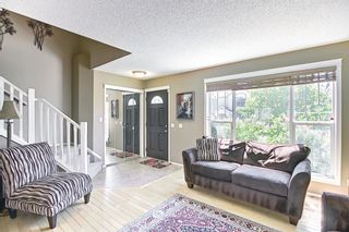 Photo 7: 83 Tuscany Springs Way NW in Calgary: Tuscany Detached for sale : MLS®# A1125563