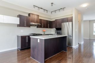 """Photo 6: 101 1125 KENSAL Place in Coquitlam: New Horizons Townhouse for sale in """"KENSAL WALK AT WINDSOR GATE"""" : MLS®# R2384199"""