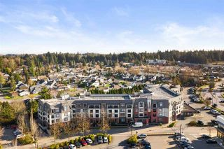 "Photo 1: 201 8880 202 Street in Langley: Walnut Grove Condo for sale in ""The Residences at Village Square"" : MLS®# R2529276"