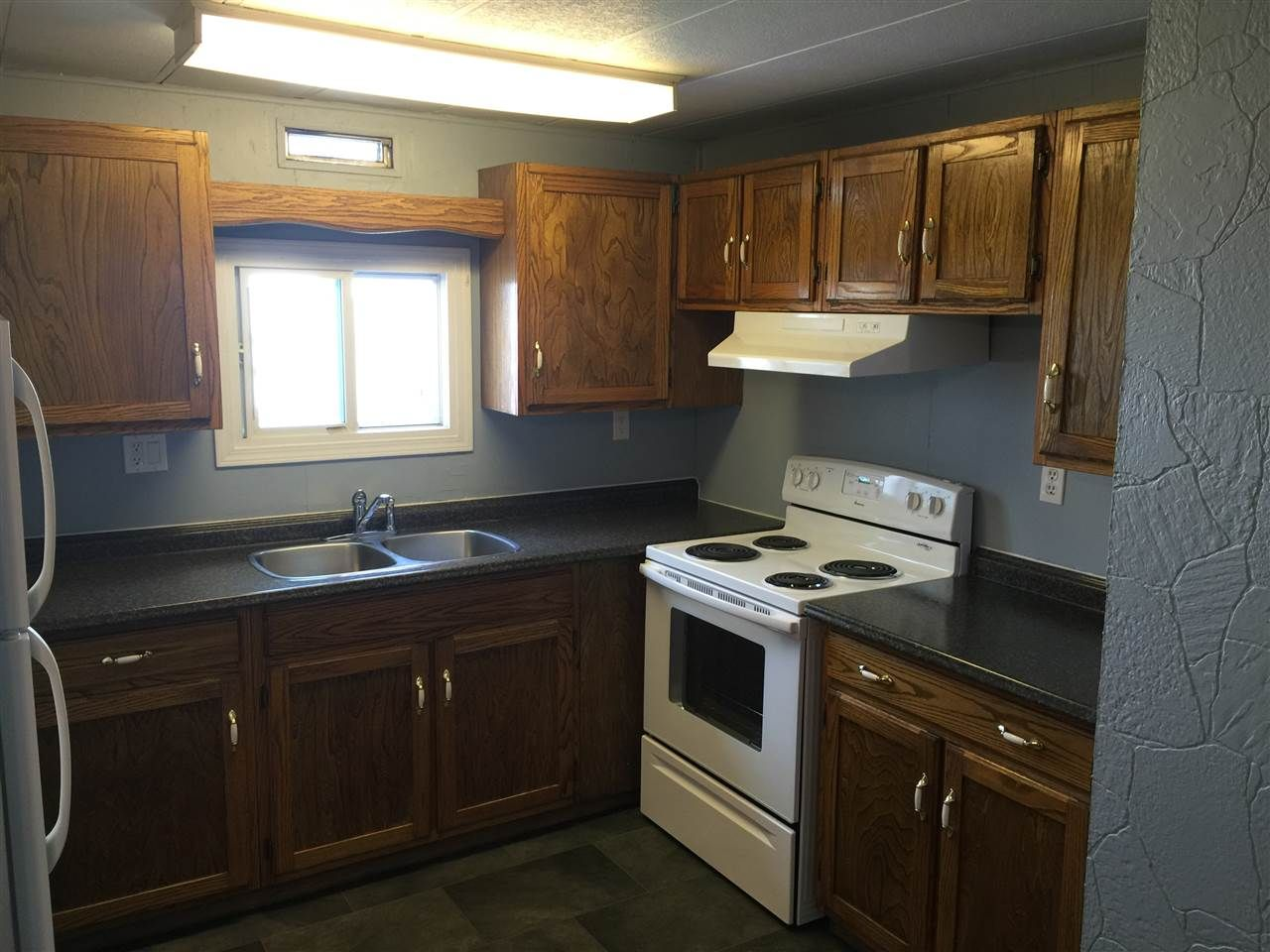 """Photo 5: Photos: 41 8420 ALASKA Road in Fort St. John: Fort St. John - City SE Manufactured Home for sale in """"PEACE COUNTRY MOBILE HOME PARK"""" (Fort St. John (Zone 60))  : MLS®# R2069792"""