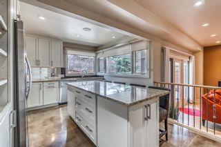 Photo 9: 424 135 Avenue SE in Calgary: Lake Bonavista Detached for sale : MLS®# A1095373