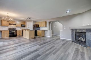 Photo 5: 52 COUGARSTONE Villa SW in Calgary: Cougar Ridge Detached for sale : MLS®# A1020063