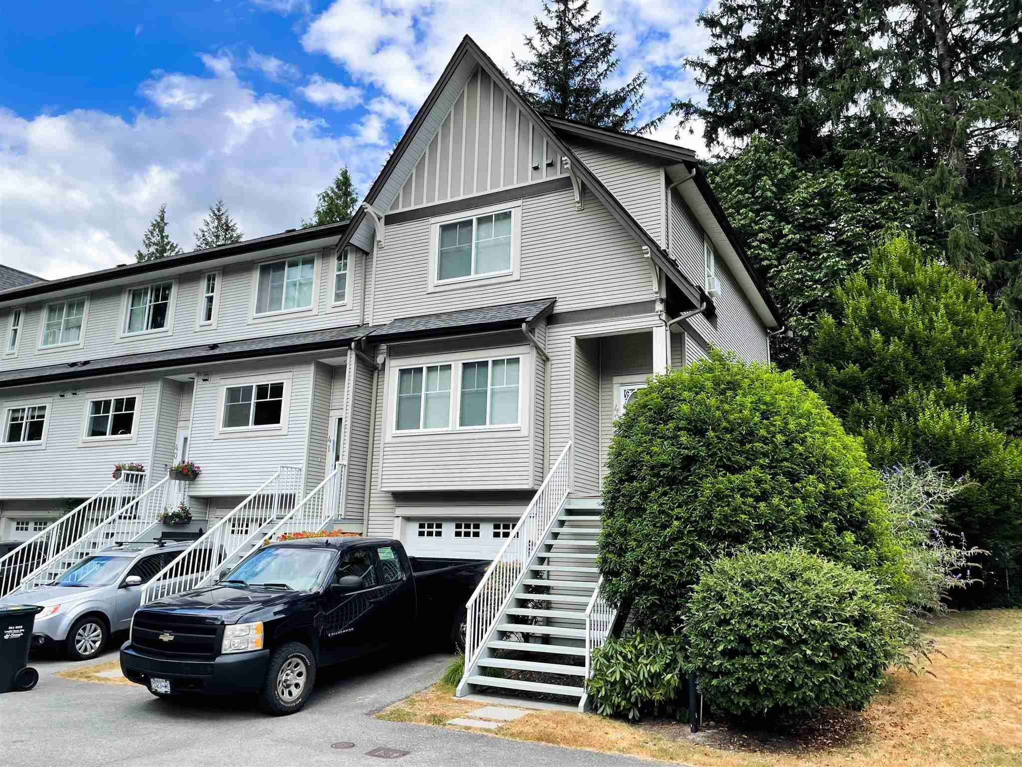 """Main Photo: 42 1800 MAMQUAM Road in Squamish: Garibaldi Estates Townhouse for sale in """"GARIBALDI ESTATES"""" : MLS®# R2604809"""