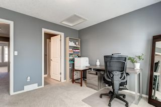Photo 18: 440 Ascot Circle SW in Calgary: Aspen Woods Row/Townhouse for sale : MLS®# A1090678