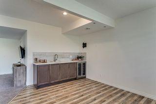 Photo 40: 142 Riviera View: Cochrane Detached for sale : MLS®# A1067592