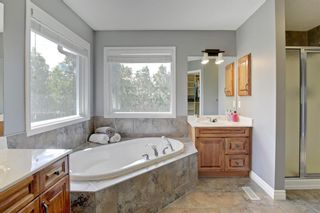 Photo 23: 145 TREMBLANT Place SW in Calgary: Springbank Hill Detached for sale : MLS®# A1024099