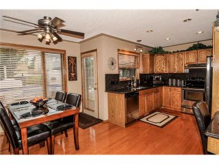 Photo 17: 39 SANDALWOOD Heights NW in Calgary: Sandstone House for sale : MLS®# C4025285
