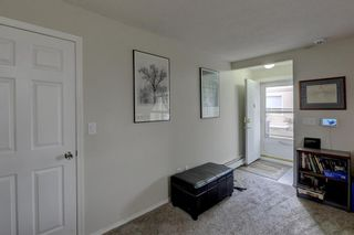 Photo 16: 103 219 Huntington Park Bay NW in Calgary: Huntington Hills Row/Townhouse for sale : MLS®# A1093664