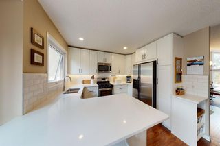Photo 10: 9 Hawkbury Place NW in Calgary: Hawkwood Detached for sale : MLS®# A1136122