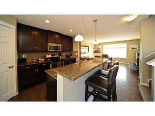 Photo 1: 14 COUNTRY VILLAGE Gate NE in CALGARY: Country Hills Village Townhouse for sale (Calgary)  : MLS®# C3578013