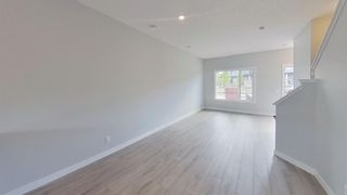Photo 10: 167 Lucas Boulevard NW in Calgary: Livingston Row/Townhouse for sale : MLS®# A1142913