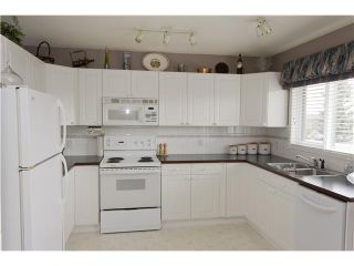 Photo 4: 28 200 SANDSTONE Drive NW in CALGARY: Sandstone Townhouse for sale (Calgary)  : MLS®# C3524111