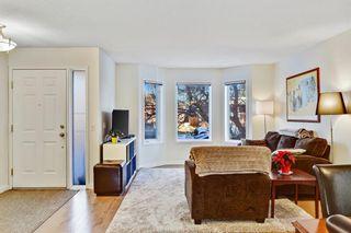 Photo 1: 735 68 Avenue SW in Calgary: Kingsland Semi Detached for sale : MLS®# A1051143
