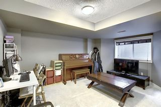 Photo 32: 47 WEST SPRINGS Lane SW in Calgary: West Springs Row/Townhouse for sale : MLS®# A1039919