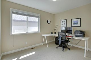 Photo 29: 145 TREMBLANT Place SW in Calgary: Springbank Hill Detached for sale : MLS®# A1024099