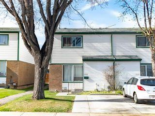 Photo 1: 118 Pennsylvania Road SE in Calgary: Penbrooke Meadows Row/Townhouse for sale : MLS®# A1109345