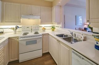 """Photo 3: 408 3600 WINDCREST Drive in North Vancouver: Roche Point Condo for sale in """"WINDSONG AT RAVENWOODS"""" : MLS®# V969491"""