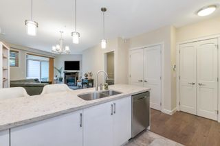 """Photo 12: 306 14588 MCDOUGALL Drive in Surrey: King George Corridor Condo for sale in """"Forest Ridge"""" (South Surrey White Rock)  : MLS®# R2615128"""