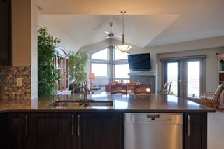 Photo 18: 40 Cougar Ridge Landing SW in Calgary: Cougar Ridge Row/Townhouse for sale : MLS®# A1148928