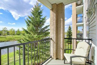 Photo 1: 204 300 Edwards Way NW: Airdrie Apartment for sale : MLS®# A1111430