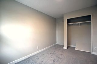 Photo 21: 77 123 Queensland Drive SE in Calgary: Queensland Row/Townhouse for sale : MLS®# A1145434