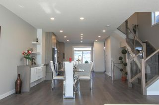 Photo 3: 2410 54 Avenue SW in Calgary: North Glenmore Park Semi Detached for sale : MLS®# A1082680