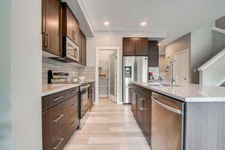 Photo 15: 235 39 Avenue NW in Edmonton: Zone 30 House Half Duplex for sale : MLS®# E4261907