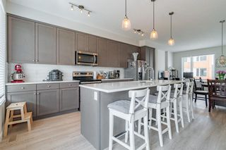Photo 11: 145 Shawnee Common SW in Calgary: Shawnee Slopes Row/Townhouse for sale : MLS®# A1097036