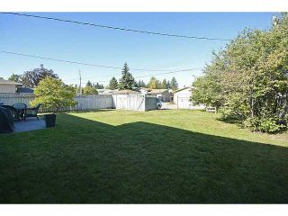 Photo 3: 1404 LAKE MICHIGAN Crescent SE in CALGARY: Lk Bonavista Downs Residential Detached Single Family for sale (Calgary)  : MLS®# C3635964