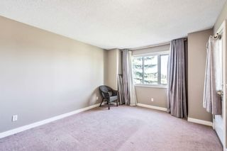 Photo 13: 60 388 Sandarac Drive NW in Calgary: Sandstone Valley Row/Townhouse for sale : MLS®# A1144717