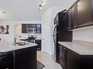 Photo 11: 204 150 PANATELLA Landing NW in Calgary: Panorama Hills Row/Townhouse for sale : MLS®# A1022269