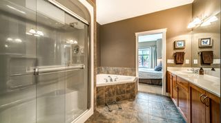 Photo 30: 38 Somme Boulevard SW in Calgary: Garrison Woods Row/Townhouse for sale : MLS®# A1112371