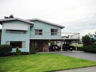 Photo 1: 3287 Regina Street in Port Coquitlam: House for sale