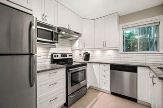 """Photo 8: 3461 AMBERLY Place in Vancouver: Champlain Heights Townhouse for sale in """"TIFFANY RIDGE"""" (Vancouver East)  : MLS®# R2587797"""
