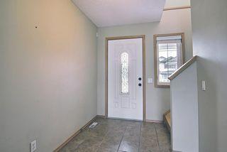 Photo 3: 47 Bow Ridge Crescent: Cochrane Detached for sale : MLS®# A1110520
