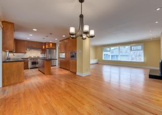 Photo 9: 7308 11 Street SW in Calgary: Kelvin Grove Detached for sale : MLS®# A1100698