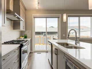 Photo 18: 105 Seton Terrace SE in Calgary: Seton Semi Detached for sale : MLS®# A1009994